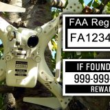 Drone with FAA labels stuck in tree